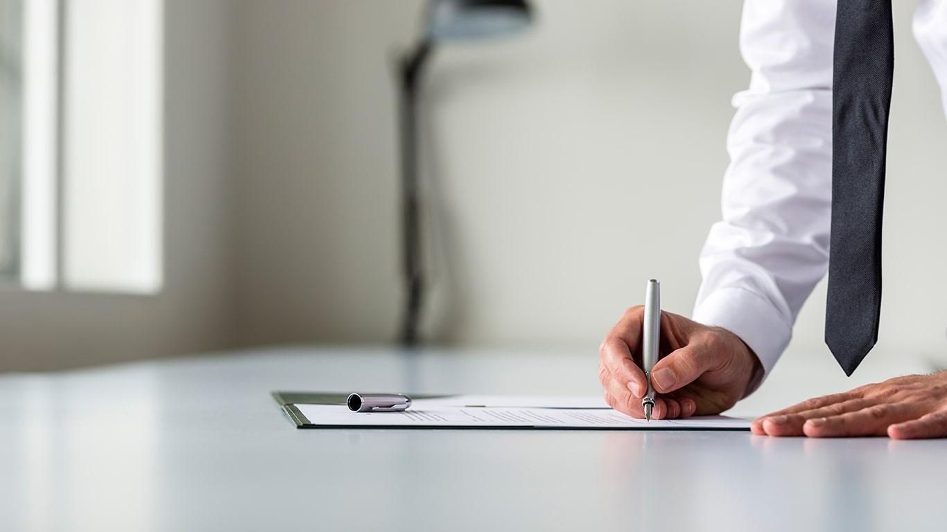 Man in white shirt writing